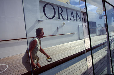 A passenger plays deck games aboard the P&O Cruise Liner Oriana