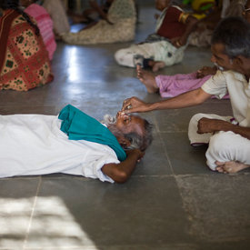 Selvaraj pinches Venugopal's nose before an exercise class at the Tamaraikulum Elders village