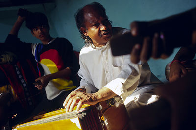 India - New Delhi - Bhagwan Das Bhatt, rehearses in his home.