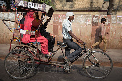 Cycle rickshaw is still a common mode of transport in some parts of Delhi, India. The drivers are very often homeless.