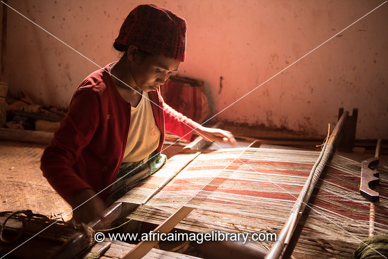 Silk weaver at work, Soatanana silk village, Madagascar