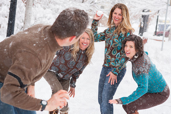 snowball fight between man and three women