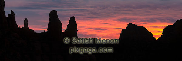 Rocks silhouetted against warm morning sky, Sedona, Arizona, USA (Composite image - sky added later)