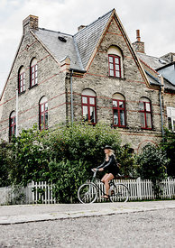 Danish woman biking in Copenhagen 6
