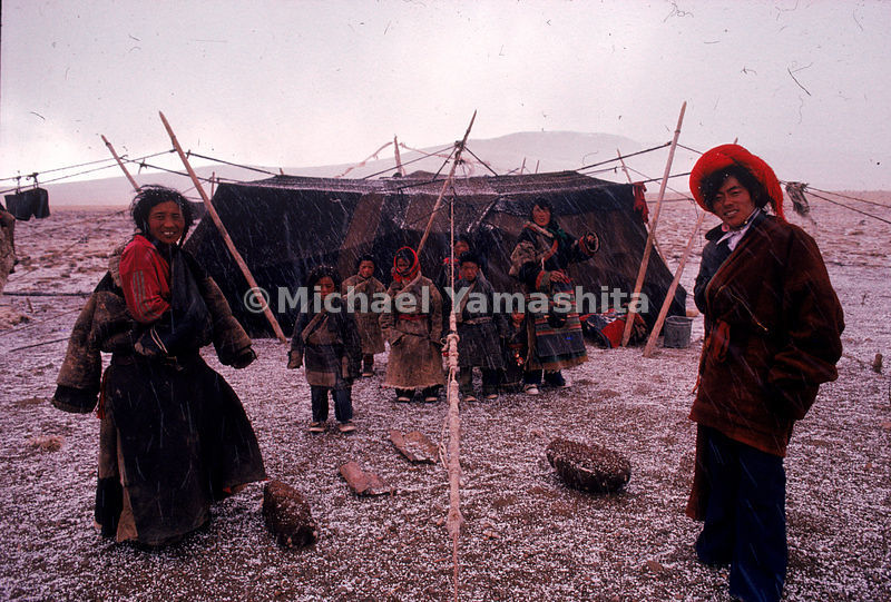 A Tibetan family at an encampment near the sacred source of the Mekong. A yak-skin tent houses Meiga, a guide, Daji, his wife, their six children, and his brother-in-law, Bachairen.