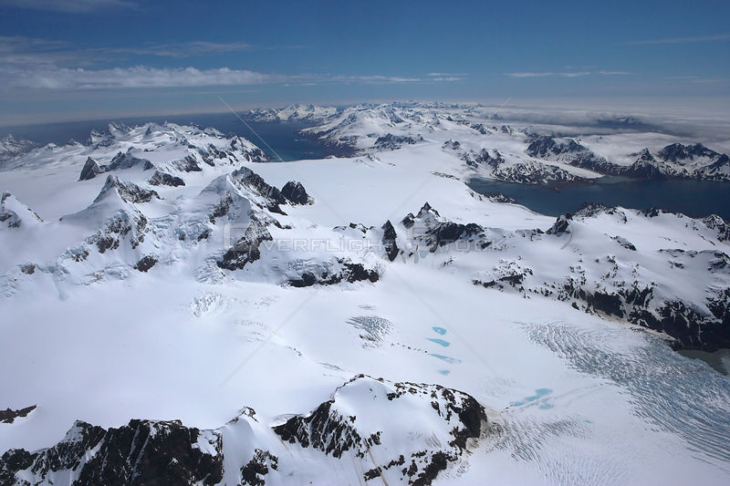 Aerial view from Briggs Glacier towards King Haakon Bay, South Georgia, Antarctica, December 2006