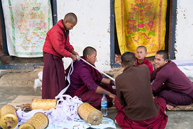 Monks cleaning prayer wheels at Gangteng Monastery, generally known as Gangtey Gonpa or Gangtey Monastery in the Wangdue Phodrang District in central Bhutan. .It is an important monastery of Nyingmapa school of Buddhism, the main seat of the Pema Lingpa tradition.