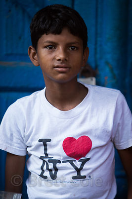 "A Muslim boy wears an ""I Love New York"" t-shirt near Jama Masjid Mosque, Delhi, India"