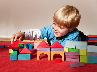boy with toy building blocks