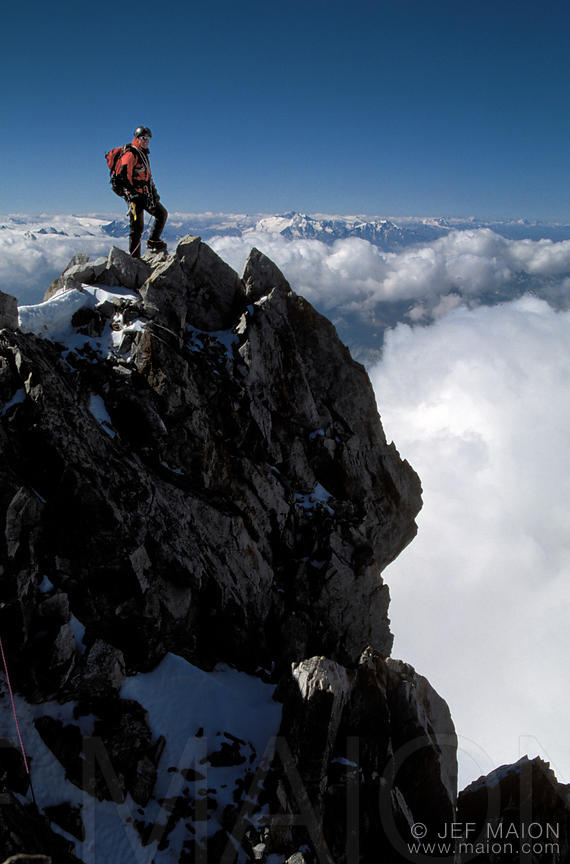 Climber on the Rochefort Aiguille summit