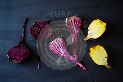Yellow and purple Beets on a dark background