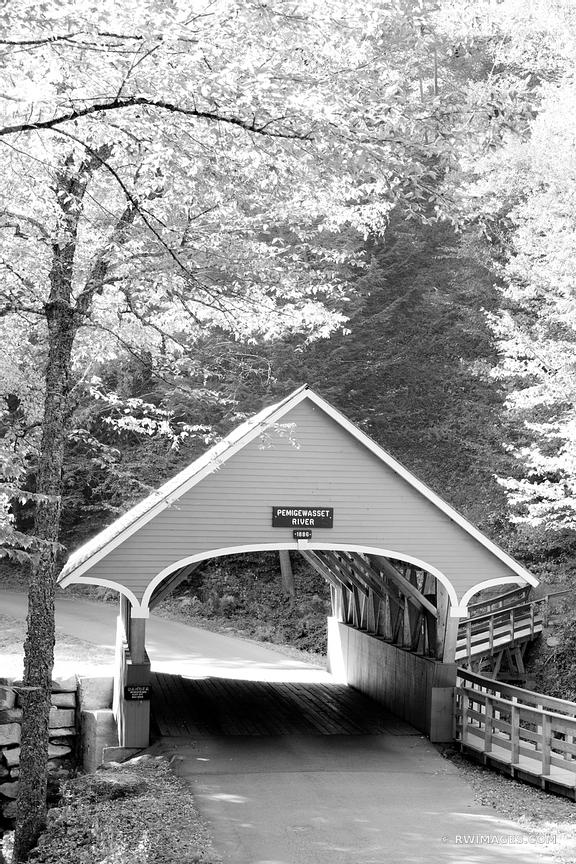 COVERED BRIDGE ON PEMIGEWASSET RIVER FRANCONIA NOTCH STATE PARK NEW HAMPSHIRE VERTICAL BLACK AND WHITE