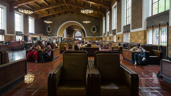 Medium Shot: Horizontal Motion Of Seating In Union Station's Central Hall