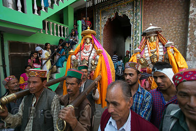 Men carry idols of Lord Raghunath during the Dussehra festival in Kullu, India