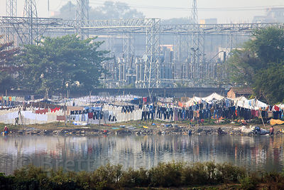 "An outdoor laundry (""Dhobi ghat"") at a small lake near a power station, near Science City, Kolkata, India."