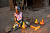 Woman making pottery, lake Niassa, Mozambique