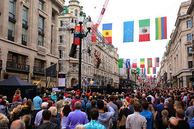 Crowd in Central London Street Watching Aerial Performers