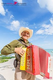 Accordion player on the beach, Playa del Carmen, Mexico