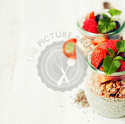 Chia seeds vanilla pudding and berries on wooden rustic background