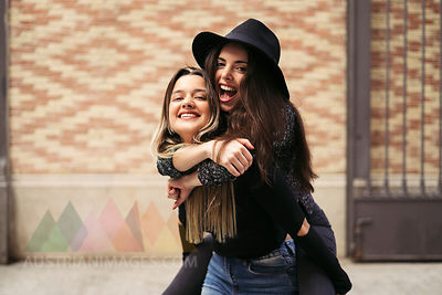 Woman giving her best a friend a piggyback ride