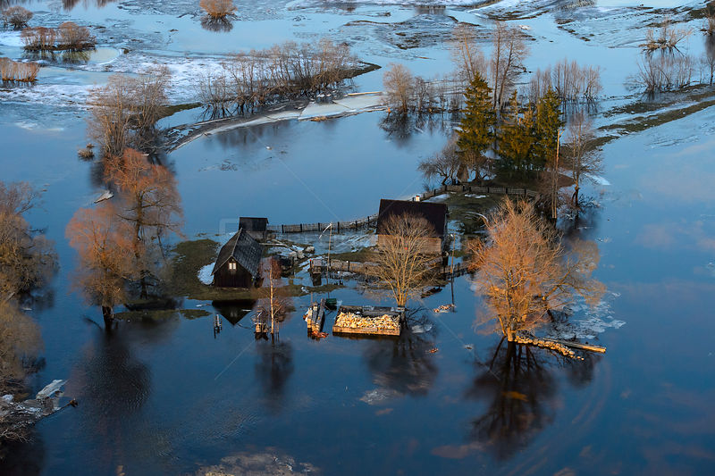 Aerial view of houses flooded by  spring melt,  Soomaa National Park. Parnumaa county, Estonia, April 2013.