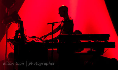 Sillhouette of Mark Kelly, keyboards, Marillion, Wolverhampton UK, 2013