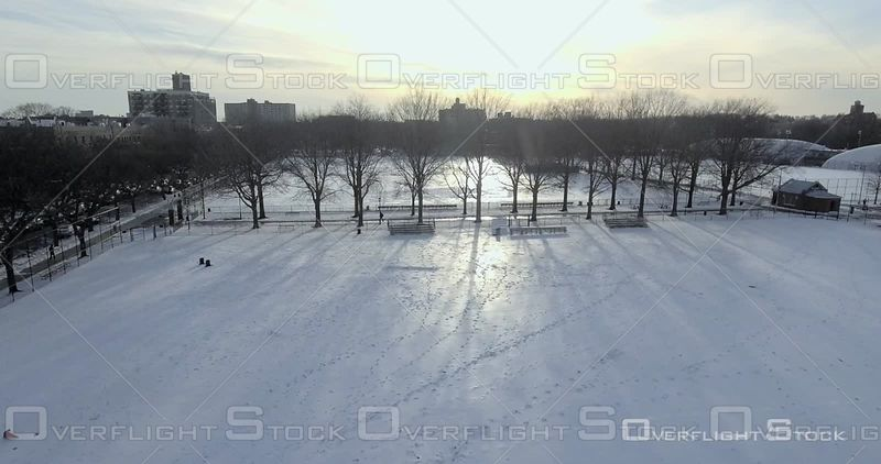 Aerial Over Snow Covered Soccer Football Fields Trees Silhouette Winter Day Brooklyn Prospect Park Sunset NYC