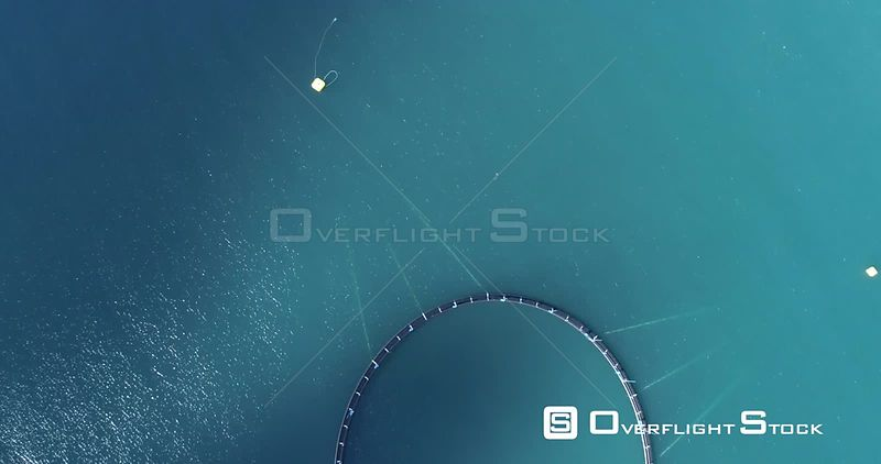 Aerial Flying Over Ocean Fish Farm Pens, Looking Straight Down, Iceland