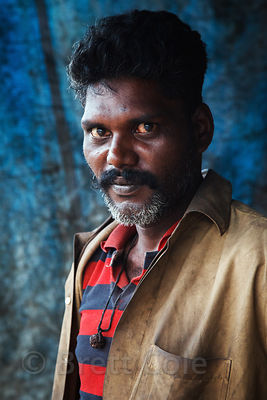 Portrait of a man in the Dharavi slum, Mumbai, India.