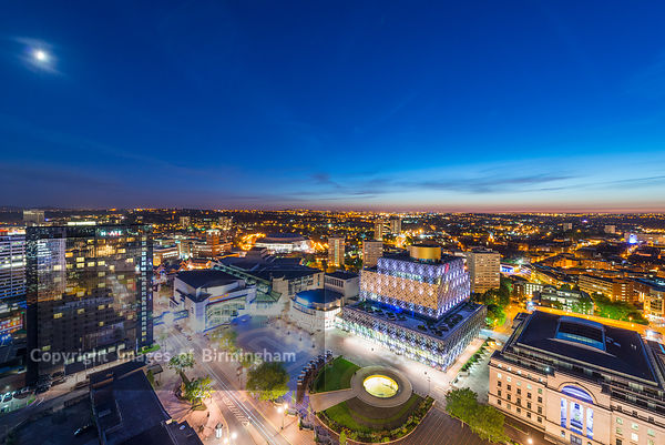 A night view of Birmingham city centre at night, showing Centenary Square and the new library of Birmingham.