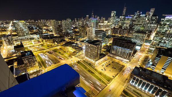 Bird's Eye: Gold Lit Kennedy Expressway Below Chicago's Skyline