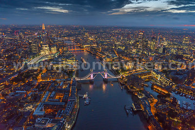 Aerial view of London and Tower Bridge at night.