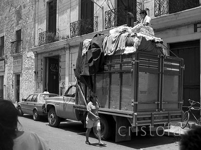 Truck piled high with rugs in Oaxaca