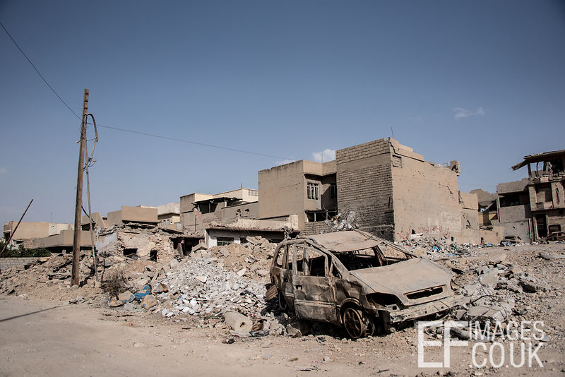 A common scene in West Mosul, burnt out vehicles and rubble heaps. Mosul, Iraq, 5th June 2017
