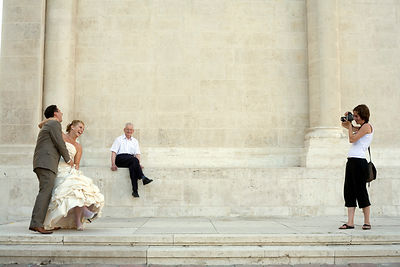 Hungary - Pecs - A newlywed couple pose for a photographer