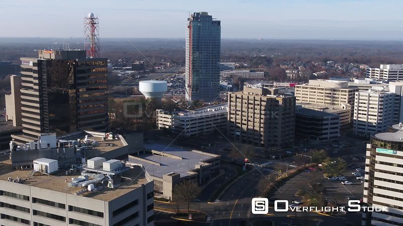 Tysons, Virginia, USA. Descending pan across the Tysons Corner skyline and the Galleria parking lot in the morning.