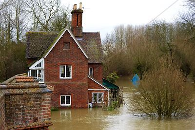 Red Brick House Standing in Flood Water on the banks of the River Thames