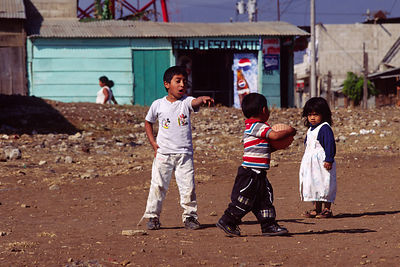 Children playing with a ball in a shanty near Tegucigalpa