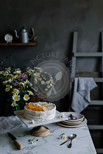 Peach pie on a table in a rustic kitchen