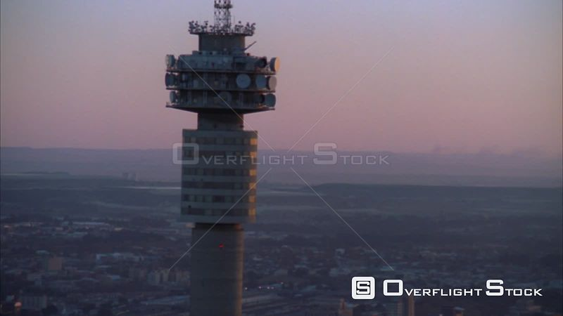 Aerial shot of the Hillbrow Tower towering above the Johannesburg Central Business District and passing the Ponte Tower during sunset/sunrise. Johannesburg Gauteng South Africa
