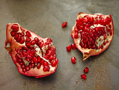 Torn open pomegranate halves
