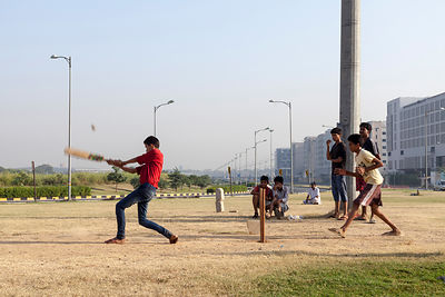 India - New Delhi - Boys play cricket on the private traffic greens at Aerocity near Terminal 3 of Indira Gandhi Airport