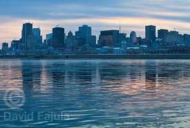 Montreal skyline at sunset, above the Saint Laurence river (fleuve Saint-Laurent)