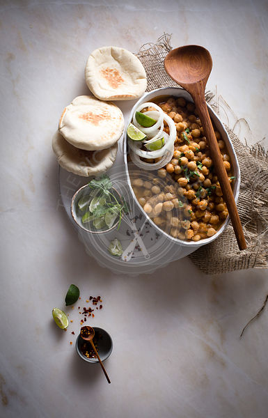 Curried chickpeas with pita bread on top view