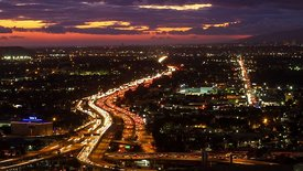 Bird's Eye: Pastel Sunset & Clouds Dimming Over A Colorful Freeway Rush Hour