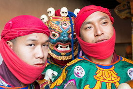 Dancers with traditional costumes and masks at the festival in Punakha Dzong, Bhutan.
