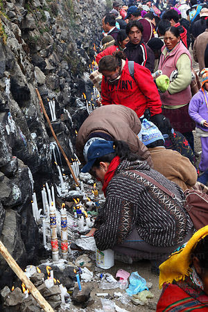 Devotees lighting candles outside Sanctuary, Qoyllur Riti festival, Peru