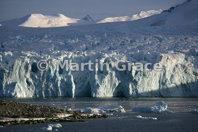 Glacier behind tip of rocky Stonington Island in Marguerite Bay, West Graham Land, Antarctica