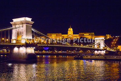 Buda Castle Illuminated at Night with the Chain Bridge in the Foreground