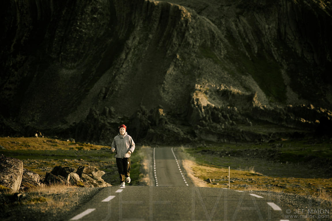 Woman running on scenic road